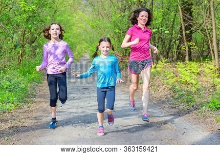 Family Sport And Fitness, Happy Active Mother And Kids Jogging Outdoors, Running In Forest, Healthy