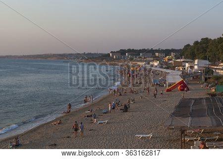 Sevastopol, Crimea, Russia - July 28, 2019: Evening View Of The Uchkuevka Beach In The City Of Sevas