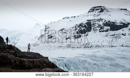 Unrecognised People Standing At The Hill And Enjoy The Vatnajokull Glacier In Iceland Which Is The L