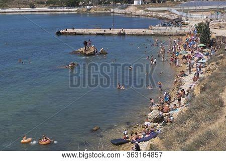 Sevastopol, Crimea, Russia - July 28, 2019: Konstantinovsky Beach In The City Of Sevastopol, Crimea