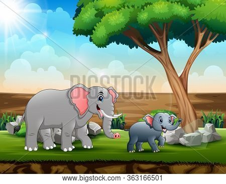 Mom And Young Elephants In The Savanna