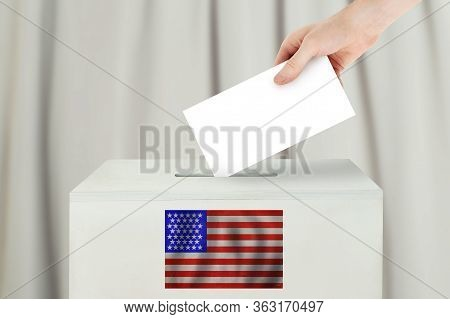 Usa Vote Concept. Voter Hand Holding Ballot Paper For Election Vote On Polling Station