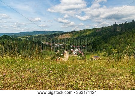 Nova Bystrica Village With Hilly Surrounding In Kysuce Region In Slovakia During Nice Summer Day Wit