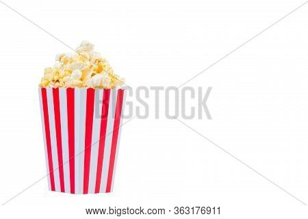 Popcorn In Red And White Striped Cardboard Bucket Isolated On White Background. Movie Popcorn Isolat