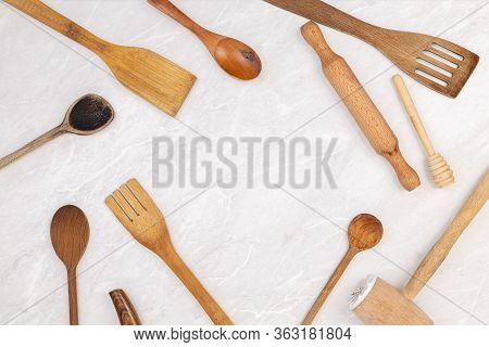 Top View Of Kitchen Wooden Utensils On The Grey Marble Kitchen Table Top With Copy Space. Food Conce