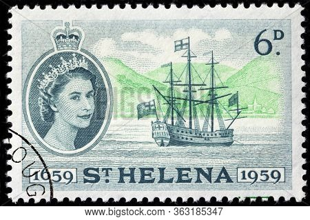 Luga, Russia - April 10, 2020: A Stamp Printed By Saint Helena Shows View Of East Indiaman Sailing S
