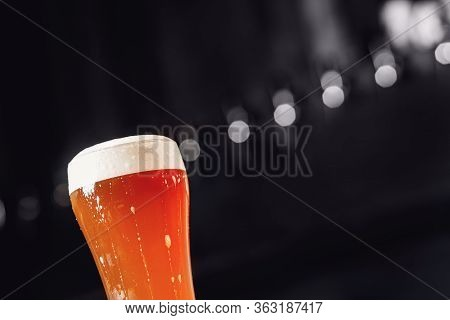 Gold Yellow Light Beer With Froth And Bubbles In Glass, Copy Space