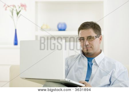 Casual Man Using Laptop