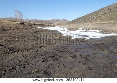 Harsh Nature Landscape And Road Through Fields And Mountains Along The Riverbed For Off-road Suv Wit