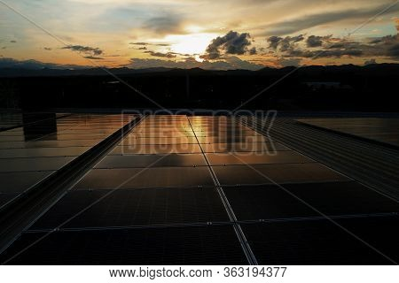 Solar Pv Rooftop With Beautiful Sunset Sky