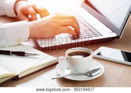 Business Man Working At Office With Laptop On His Desk. Close-up Of Male Hand Typing On Computer Key