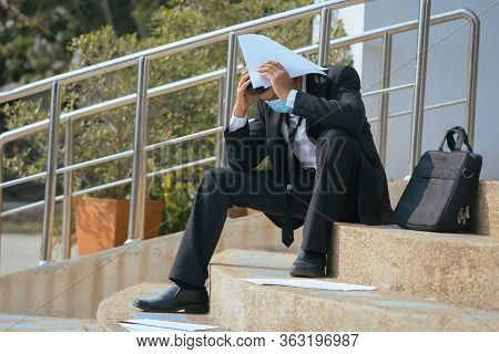 Business Unemployed Businessman Stress Sitting On Stair Due To The Situation Covid 19,concept Of Bus