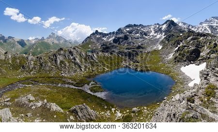 The Lac Bleu In Chianale, Mountain Lake In The Italian Alps Of Cuneo, Piedmont, Facing The Famous Mo