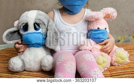 Masked Child - Protection Against Influenza Virus. Little Caucasian Girl Wearing Mask For Protect An