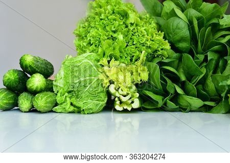 Juicy Fresh Spinach, Arugula ,lettuce Salad,cabbage,cucumbers On A White Background.fresh Organic Ra
