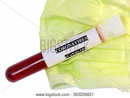 Surgical Mask And A Blood Sample For Laboratory Testing For Corona Virus Research On White Backgroun