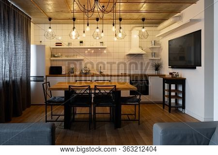 An Eat-in Kitchen Interior Design In Modern Scandinavian Style With Big Wooden Table And Chairs Agai