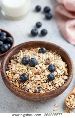Bowl Of Oat Muesli With Nuts, Dried Fruit And Blueberries. Healthy Breakfast Food, Clean Eating And