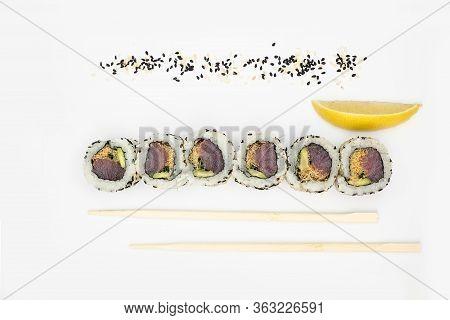 Japanese Cuisine. Maki Sushi. Isolated On White Background. Sushi Rolls Lie On A White Background, T
