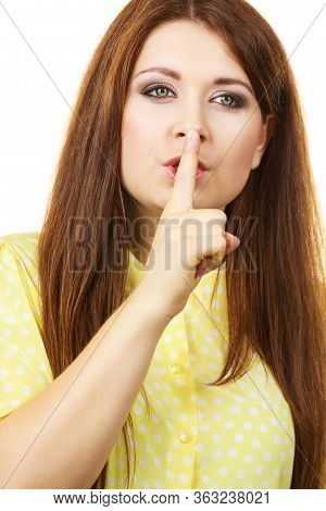 Girl Asking For Silence Or Secrecy With Finger On Lips, Hush Hand Gesture, On White.