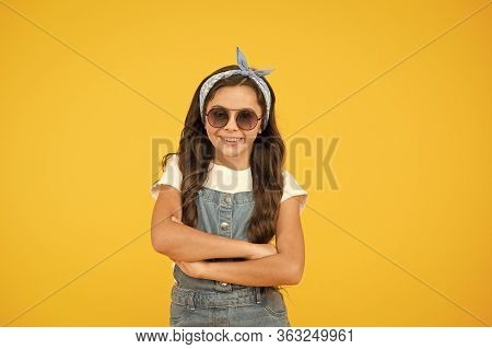 Ready For Sunny Weather. Summer Fashion Concept. Cheerful Little Girl Yellow Background. Retro Kid L