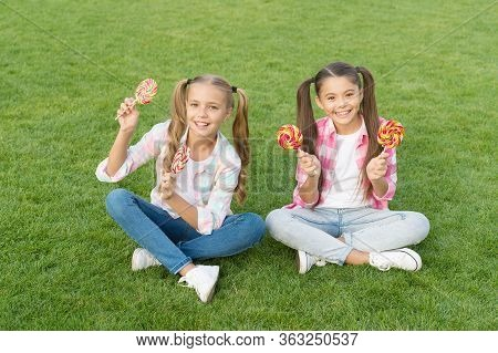 Enjoy These Lollipops With Taste Sensation. Happy Children Hold Lollipops Green Grass. Eating Large