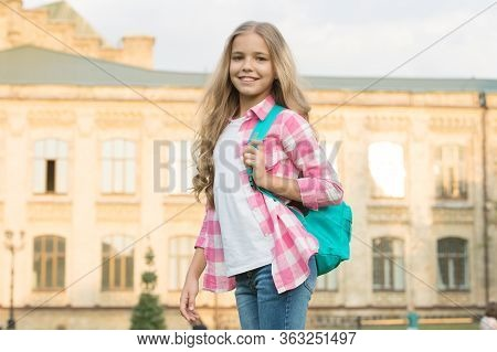 First Day Of School. Happy Child Back To School. Elementary School Pupil Outdoors. School And Educat