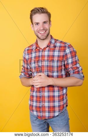 Happy Man In Checkered Shirt On Yellow Background. Sexy And Confident. Boy Casual Style. Barber Man