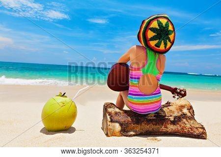 Little Baby In Rasta Hat Play Reggae Music On Hawaiian Ukulele, Enjoy Relaxing On Ocean Beach. Kids