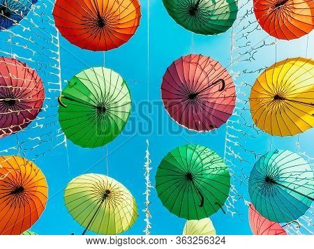 Multicolored Umbrellas Closeup On The Blue Sky Background