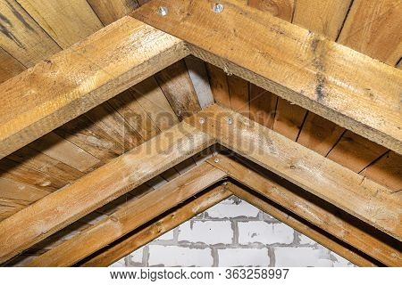 Roof Made Of Rafter-type Roof Truss, Close-up View From The Inside, Wooden Roof.