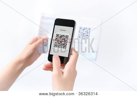 Woman Scanning Qr Code In The Magazine
