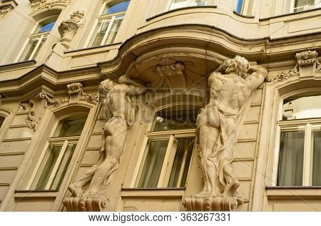 Vienna, Austria - June 3, 2019: The Ornately Carved Statues Of Two Male Figures On A Building Exteri