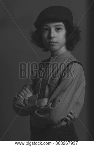 Portrait Of A Boy In A Cap. Vintage Stylization. Black And White.