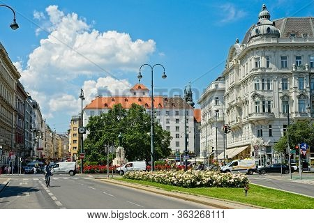 Vienna, Austria - June 4, 2019: Elegant Old Buildings And Colorful Flowerbeds Create A Picturesque,