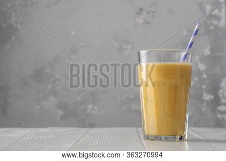 Fruit Protein Shake On A White Wooden Table. Fresh Milkshake With Passion Fruit. A Glass Of Protein