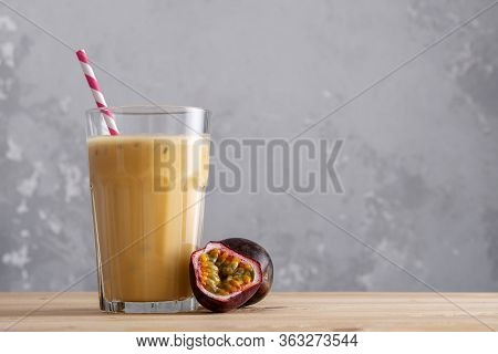 Fruit Protein Shake On A Wooden Table. Fresh Milkshake With Passion Fruit. A Glass Of Protein Shake.