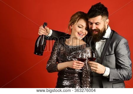 Lady And Gentleman Celebrating With Merlot. Woman In Sparkling Dress