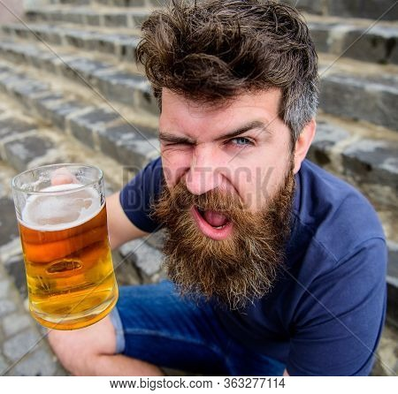 Celebration Concept. Guy Having Rest With Draught Beer. Man With Beard And Mustache Holds Glass With