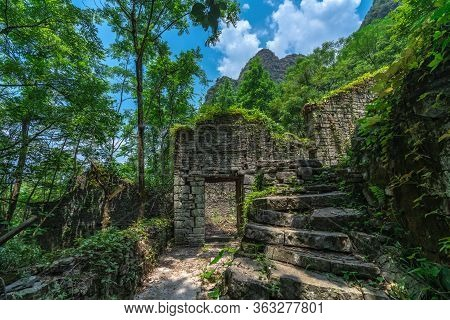 Empty, Ruined And Overgrown By Tropical Plants Ancient And Old Abandoned Houses Of A Local Village L
