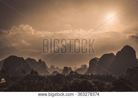 Beautiful Impressive Karst Mountain Landscape In Yangshuo Before Dusk On A Sunny Hot Overcast Summer
