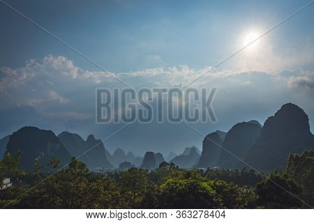 Beautiful Impressive Karst Mountain Landscape In Yangshuo On A Sunny Hot Overcast Summer Day, Guangx