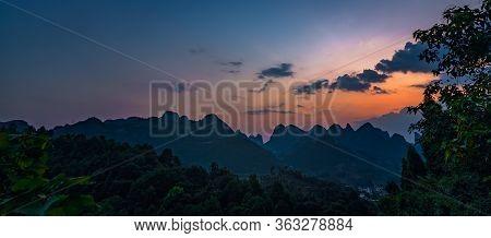 Xianggong Hill Viewpoint View Of Beautiful Green, Lush And Dense Karst Mountain Landscape At Sunset,