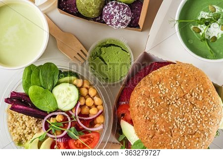 Healthy Vegan Food Delivery. Buddha Bowl Salad, Burger, Soup, Dessert And Matcha Latte Packed In Box