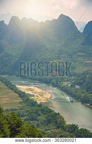 Shot Of A Li River Meandering Through The Beautiful Green, Lush And Dense Karst Mountain Landscape I