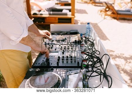 Dj Plays Music On The Beach. Dj Mixing Beach Party In Summer Vacation Outdoor. Disc Jockey Hands Pla