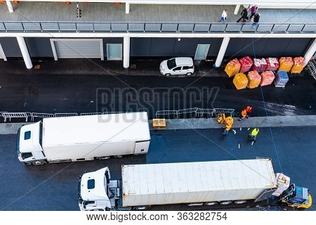 Asphalt Road At Shipping/ Shipment/ Cargo Delivery Port. White 10 Wheeler Freight Truck And 18 Wheel