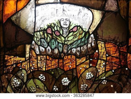 ELLWANGEN, GERMANY - MAY 05, 2014: Creator Spirit penetrates deep into the world and lead a life, stained glass window by Sieger Koder at Holy Spirit church in Ellwangen, Germany