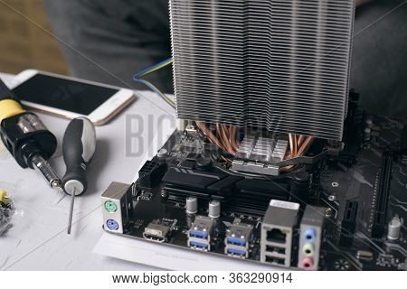 Computer Technician Installs Cooling System Of Computer. Engineer Repairing Computer (pc) Board. Tec