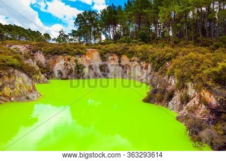 Devil's Bath with bright green water. Wai-O-Tapu, Volcanic Valley Waimangu. The unique geothermal area of Rotorua. New Zealand, North Island. Extreme, exotic and photo tourism concept